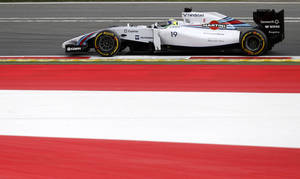 Photo - Williams driver Felipe Massa of Brazil steers his car during the third practice session for Sunday's Austrian Grand Prix at the Spielberg track, Austria, Saturday, June 21, 2014. The Austrian Grand Prix will be held Sunday, June 22, 2014. (AP Photo/Darko Vojinovic)