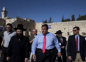 Photo -   New Jersey Gov. Chris Christie, center, walks at the Western Wall, the holiest site where Jews can pray, during his visit to Jerusalem's old city, Monday, April 2, 2012. Christie kicked off his first official overseas trip Monday meeting Israel's leader in a visit that may boost the rising Republican star's foreign policy credentials ahead of November's presidential election. (AP Photo/Sebastian Scheiner)