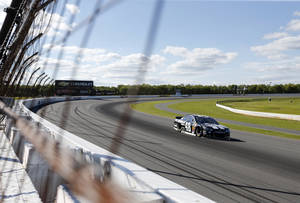 Photo - Jimmie Johnson (48) qualifies for Sunday's NASCAR Sprint Cup Series auto race at Pocono Raceway on Friday, June 6, 2014, in Long Pond, Pa. (AP Photo/Mike Groll)