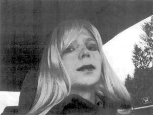 Photo - FILE - In this undated file photo provided by the U.S. Army, Pfc. Chelsea Manning poses for a photo wearing a wig and lipstick. In an unprecedented move, the Pentagon is trying to transfer convicted national security leaker Pvt. Chelsea Manning to a civilian prison so she can get treatment for her gender disorder, defense officials said Tuesday May 13, 2014.  (AP Photo/U.S. Army, File)