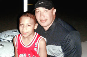 Photo - Dominique Coursey, pictured with his son Dominique Bobby Coursey Jr., plays pro basketball in Mexico. Provided Photo