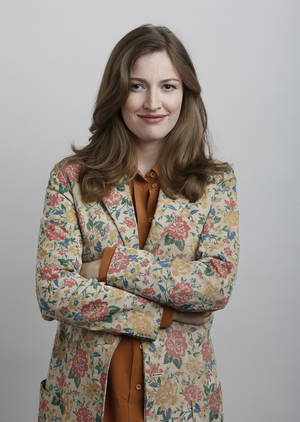 "Photo -   In this June 18, 2012 photo, actress Kelly Macdonald poses for a portrait during the ""Brave"" press day at Loews Hollywood Hotel, in Los Angeles. The top spot at the box office is rare turf for Kelly Macdonald, a character actress known on the big-screen mainly for supporting roles in such films as ""No Country for Old Men"" and ""Finding Neverland."" With her wild red mane and her killer skills with sword and bow, Macdonald has become the latest in Hollywood's growing line of successful female action heroes. (Photo by Todd Williamson/Invision/AP)"