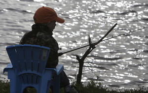 Photo - Ty Marshall Shoffner, 5, fishes during the Kids Fishing Derby at Arcadia Lake.