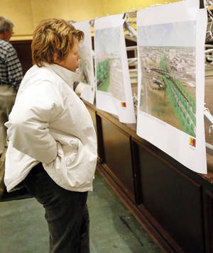 photo - Elizabeth Wylie looks at drawings of a proposed design for the Oklahoma City Boulevard before a public meeting Monday night at the Coca-Cola Bricktown Events Center in Oklahoma City.