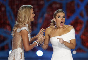 Photo - Miss New York, Mallory Hagan, right, reacts with Miss South Carolina Ali Rogers as she is crowned Miss America 2013 on Saturday, Jan. 12, 2013, in Las Vegas. (AP Photo/Isaac Brekken)