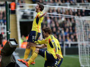 Photo - Sunderland's Fabio Borini, left, celebrates his goal during their English Premier League soccer match against Newcastle United at St James' Park, Newcastle, England, Saturday, Feb. 1, 2014. (AP Photo/Scott Heppell)