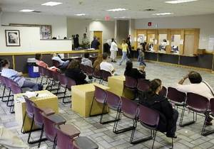 photo - People wait for a caseworker at the DHS office, April 26, 2010. Stephen Pingry/Tulsa World