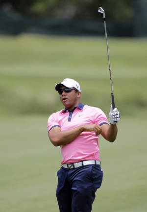 photo -   Jhonattan Vegas, of Venezuela, reacts to his shot on the fifth fairway during the third round of the Players Championship golf tournament at TPC Sawgrass, Saturday, May 12, 2012, in Ponte Vedra Beach, Fla. (AP Photo/John Raoux)