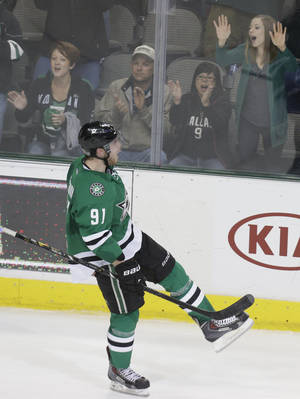 Photo - Dallas Stars center Tyler Seguin (91) celebrates scoring a goal during an overtime shootout  during an NHL hockey game against the Nashville Predators  Tuesday, April 8, 2014, in Dallas. Dallas won 3-2. (AP Photo/LM Otero)