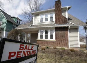 Photo - This Friday, March 21, 2014 photo shows a home for sale in Cleveland Heights, Ohio. The National Association of Realtors releases pending home sales index for February, on Thursday, March, 27, 2014. (AP Photo/Tony Dejak)
