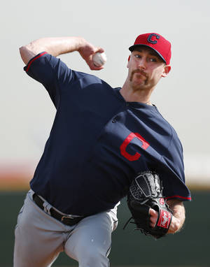 Photo - FILE - In this Feb. 21, 2014 file photo, Cleveland Indians pitcher John Axford throws during spring training baseball practice in Goodyear, Ariz. After converting 49 consecutive saves from 2011 to early 2012, Axford has another streak going. The Indians closer went 18 for 18 on his Academy Awards picks.  (AP Photo/Paul Sancya, File)