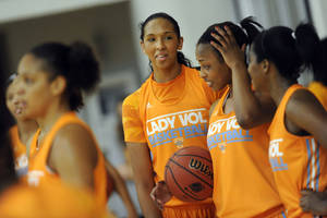 Photo - Tennessee freshman Mercedes Russell, center, gathers with teammate during NCAA college basketball practice Tuesday, Oct. 1, 2013, in Knoxville, Tenn.  The Lady Vols say having the Final Four in nearby Nashville gives them extra incentive. (AP Photo/Knoxville News Sentinel, Adam Lau)