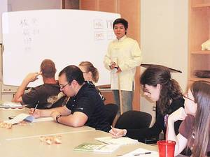 Photo - Participants in OU's Chinese Crosstalk program work on vocabulary words under the supervision of instructor Chen Wu. PHOTO PROVIDED