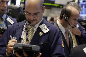 Photo - In this Tuesday, Aug. 27, 2013 photo, Luigi Muccitelli, center, works with fellow traders on the floor of the New York Stock Exchange.  (AP Photo/Richard Drew)