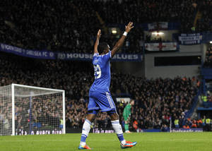 Photo - Chelsea's Samuel Eto'o celebrates after scoring his 3rd goal against Manchester United's during their English Premier League soccer match at Stamford Bridge, London, Sunday, Jan. 19, 2014. (AP Photo/Sang Tan)