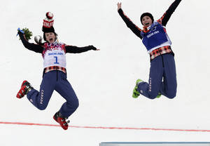 Photo - Women's ski cross gold medalist Marielle Thompson of Canada, right, celebrates on the podium with silver medalist and compatriot Kelsey Serwa, left, at the Rosa Khutor Extreme Park, at the 2014 Winter Olympics, Friday, Feb. 21, 2014, in Krasnaya Polyana, Russia. (AP Photo/Andy Wong)