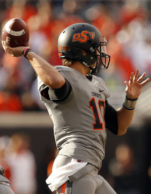 photo - Oklahoma State's Clint Chelf (10) throws the ball during a college football game between Oklahoma State University (OSU) and the West Virginia University at Boone Pickens Stadium in Stillwater, Okla., Saturday, Nov. 10, 2012. OSU won 55-34. Photo by Sarah Phipps, The Oklahoman