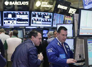 photo - Stock traders work at the New York Stock Exchange, Monday, Feb. 4, 2013. (AP Photo/Mark Lennihan)