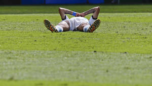 Photo - Argentina's Angel di Maria lays on the pitch  after getting injured during the World Cup quarterfinal soccer match between Argentina and Belgium at the Estadio Nacional in Brasilia, Brazil, Saturday, July 5, 2014. (AP Photo/Frank Augstein)
