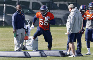 Photo - Denver Broncos linebacker Von Miller works out during practice at the NFL football team's practice facility in Englewood, Colo., on Wednesday, Oct. 16, 2013. It was the first practice with the team for Miller since August as he completed a six game suspension for violating the leagues substance abuse rules. (AP Photo/Ed Andrieski)