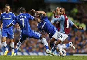 Photo - Aston Villa's Fabian Delph, right, fight for the ball with Chelsea's Ramires, left, and Frank Lampard, centre, during their English Premier League soccer match at the Stamford Bridge ground in London, Wednesday, Aug. 21, 2013. (AP Photo/Lefteris Pitarakis)