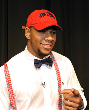 Photo - Grayson High School football player Robert Nkemdiche, the nation's top recruit, announces his intent to play college football for Ole Miss during a signing day ceremony at his high school auditorium in Grayson, Ga., Wednesday Feb. 6, 2013. (AP Photo/David Tulis) <strong>Dave Tulis</strong>
