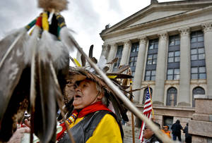 Photo - Burt Poorbuffalo speaks during a rally on the north side of the state Capitol for Native American rights on Monday, Jan. 28, 2013, in Oklahoma City, Okla.  Photo by Chris Landsberger, The Oklahoman