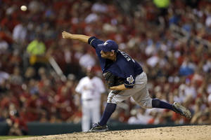 Photo - Milwaukee Brewers starting pitcher Marco Estrada throws during the fourth inning of a baseball game against the St. Louis Cardinals on Wednesday, Sept. 11, 2013, in St. Louis. (AP Photo/Jeff Roberson)