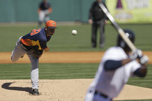 Photo - Houston Astros pitcher Jarred Cosart, left, throws to Detroit Tigers Torii Hunter, right, during the first inning of an exhibition spring training baseball game Monday, March 4, 2013, in Lakeland, Fla. (AP Photo/David J. Phillip) ORG XMIT: FLDP107