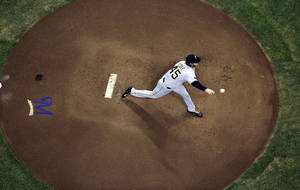 Photo - Pittsburgh Pirates starting pitcher Gerrit Cole throws during the first inning of a baseball game against the Milwaukee Brewers, Tuesday, May 13, 2014, in Milwaukee. (AP Photo/Morry Gash)