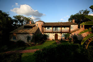 photo - Among the reasons this Spanish-style historic farmhouse exudes romance is its use of old brick and other weathered materials, its balconies and interior courtyard, and its human scale, said architectural historian and author Susan Sully. But homes don?t have to be old to be romantic.  Photo courtesy of Art Faulkner.  <strong></strong>