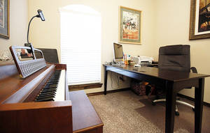 Photo - The Crawfords' study doubles as a piano studio. <strong>STEVE SISNEY - THE OKLAHOMAN</strong>
