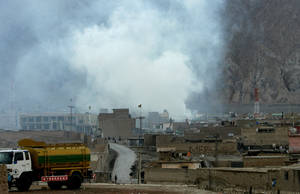 Photo - Smoke rises from the site of a bomb blast in a market in Quetta, Pakistan on Saturday, Feb. 16, 2013. Senior police officer Wazir Khan Nasir said the bomb went off in a Shiite Muslim-dominated residential suburb of the city of Quetta. Residents rushed the victims to three different hospitals.(AP Photo/Arshad Butt)
