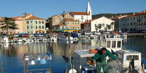 Photo - Izola, Slovenia: A fisherman sorting his net.
