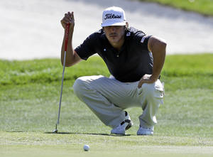 Photo - Brooks Koepka measures his putt on the ninth green during the second round of the Frys.com Open golf tournament on Friday, Oct. 11, 2013, in San Martin, Calif. (AP Photo/Marcio Jose Sanchez)