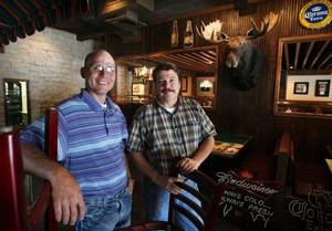 Photo - Co-owners Mikel Crowley and Jeff Stewart show a soon-to-open OConnell's Irish Pub and Grille in Norman on Thursday, August 28, 2008.    BY STEVE SISNEY, THE OKLAHOMAN