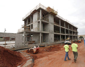 Photo -  A view of the east side of the new Public Safety Center being built at First Street and Littler Avenue. The building is part of a $27.5 million complex for police headquarters, 911 communications and emergency management operations. PHOTO BY PAUL HELLSTERN, THE OKLAHOMAN  <strong>PAUL HELLSTERN - Oklahoman</strong>
