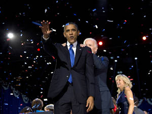 Photo -   President Barack Obama and Vice President Joe Biden celebrate on stage at the election night party at McCormick Place, Wednesday, Nov. 7, 2012, in Chicago. Obama defeated Republican challenger former Massachusetts Gov. Mitt Romney. (AP Photo/Carolyn Kaster)
