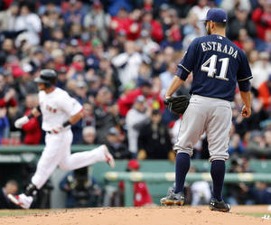 Photo - Milwaukee Brewers' Marco Estrada (41) watches as Boston Red Sox's Will Middlebrooks rounds third base on a solo home run in the third inning of a baseball game in Boston, Friday, April 4, 2014. (AP Photo/Michael Dwyer)