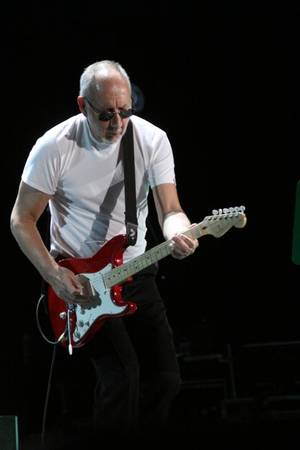 Photo - Who guitarist Pete Townshend performs Thursday night with his band at the BOK Center in Tulsa. PHOTO BY VERNON GOWDY III, FOR THE OKLAHOMAN