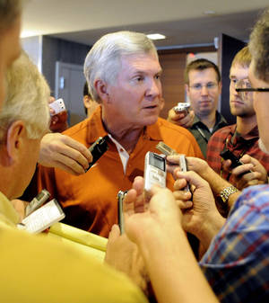 Photo - Texas head coach Mack Brown answers questions at NCAA college football Big 12 Media Days, Tuesday, July 24, 2012, in Dallas. (AP Photo/Matt Strasen)