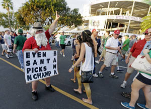 Photo - Fed Huff of New Mexico looks for tickets outside Sun Life Stadium before the BCS National Championship college football game between the Alabama and the Notre Dame Monday, Jan. 7, 2013, in Miami. (AP Photo/Chris O'Meara)