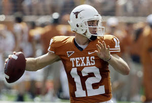 Photo - Texas is staying in the Big 12 because the conference does not share revenue equally among all schools. AP PHOTO