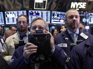 Photo - Traders work on the floor of the New York Stock Exchange, Thursday, Dec. 12, 2013. Lower U.S. stock prices on Thursday set up investors for what would be their third day in a row of declines. (AP Photo/Richard Drew)