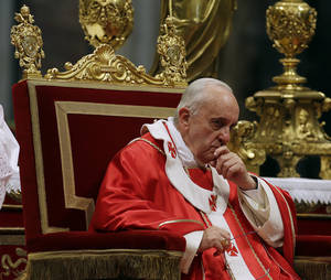Photo - Pope Francis pauses after he bestowed the Pallium to 35 Archbishops, during a mass in St. Peter's Basilica, at the Vatican, Saturday, June 29, 2013.  The Pallium is a woolen shawl symbolizing the archbishops' bond to the pope. (AP Photo/Gregorio Borgia)