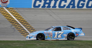Photo - Corey LaJoie crosses the finish line to win the ARCA Racing Series auto race at Chicagoland Speedway in Joliet, Ill., Sunday, July 21, 2013. (AP Photo/Nam Y. Huh)