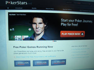 Photo - FILE- This Dec. 11, 2013 file photo shows a computer screen in Atlantic City N.J. displaying the hom page of the PokerStars web site. The Canadian company that's buying PokerStars will begin talks on Thursday June 19, 2014 with New Jersey casino regulators about getting PokerStars licensed in New Jersey. The world's largest poker web site had been suspended in New Jersey due to an unresolved indictment against its founder, who is resigning as part of the sale. (AP Photo/Wayne Parry)