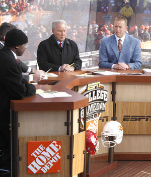 Photo - ESPN hosts Desmond Howard (left), Chris Fowler, Lee Corso, and Kirk Herbstreit coment on the day's games during Saturday's ESPN College Gameday broadcast in Stillwater, OK, Saturday, Nov. 27, 2010. By Paul Hellstern, The Oklahoman
