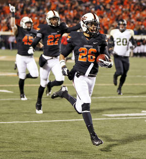 Photo - One of the highlights of Tyler Patmon's season was a 78-yard fumble return for a touchdown against Baylor. OSU won that game 49-17.  Photo by Nate Billings, The Oklahoman