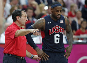Photo -   USA coach Mike Krzyzewski talks with LeBron James during a men's basketball game against Lithuania at the 2012 Summer Olympics, Saturday, Aug. 4, 2012, in London. (AP Photo/Charles Krupa)
